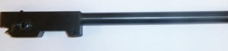 Barrel .22 cal, uses solid cocking lever and plastic washer on the right.
